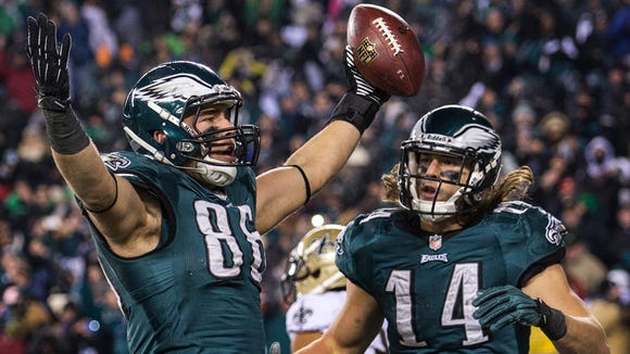 Eagles tight end Zach Ertz (No. 86) celebrates his touchdown reception with wide receiver Riley Cooper (No. 14) in the fourth quarter of the Eagles 26-24 loss to the Saints on Saturday night, January 4, 2014.