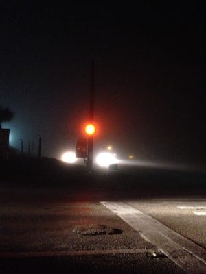Dense fog reduces visibility at U.S. 1 and Suntree Boulevard Tuesday morning.