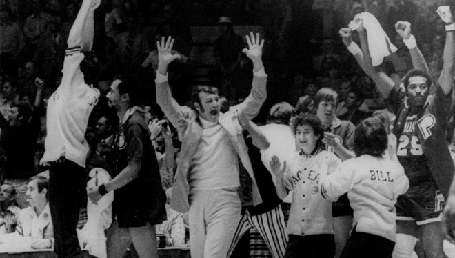 """Indiana Pacers coach Bob """"Slick"""" Leonard celebrates his team's defeat of the  Kentucky Colonels on May 12, 1973, for the Pacers' third ABA championship. Their other championships were in 1970 and 1972."""