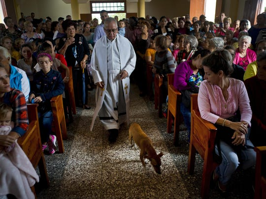 Father Cirilo Castro takes part in the consecration Mass of the Sagrado Corazon de Jesus, or Sacred Heart, Catholic church, in Sandino, Cuba, Saturday, Jan. 26, 2019. The parish is one of three Catholic churches that the Cuban government authorized to be built and the first of the three to be completely finished, with the help of Tampa's St. Lawrence Catholic Church in Florida.
