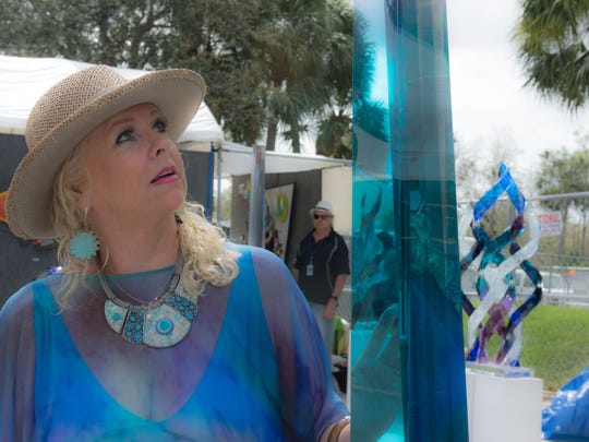 The 33rd Annual Arti Gras Fine ArtsFestival was a time of art, people and faces .It was held Feb.17 to 19 at Abacoa, in Jupiter.
