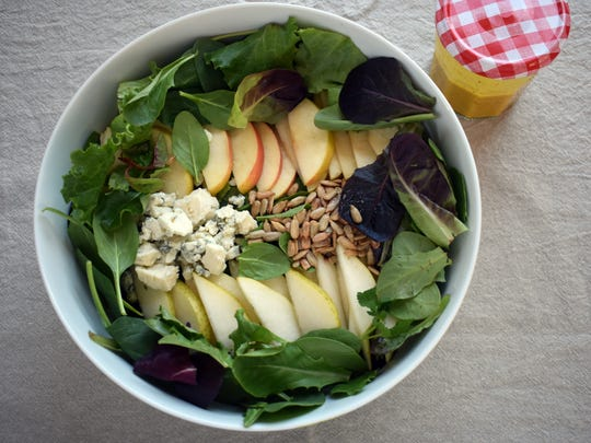 Apples, pears and Gorgonzola cheese team up with greens