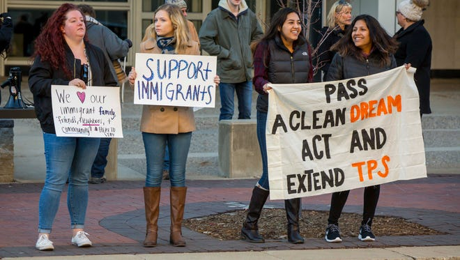 Dreamers gathered with banners, painted by Iowa Dreamers, at the Neil Smith Federal Building Friday , Dec. 1, 2017, urging Senator Grassley and Ernst and Representative Young to co-sponsor a clean Dream Act by the end of the year and support the Temporary Protective Status (TPS) Program.