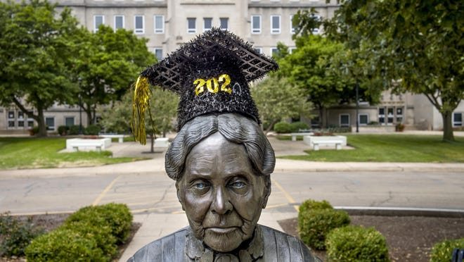 The statue of Bradley University founder Lydia Moss Bradley stands June 29 adorned with a Class of 2020 mortarboard.