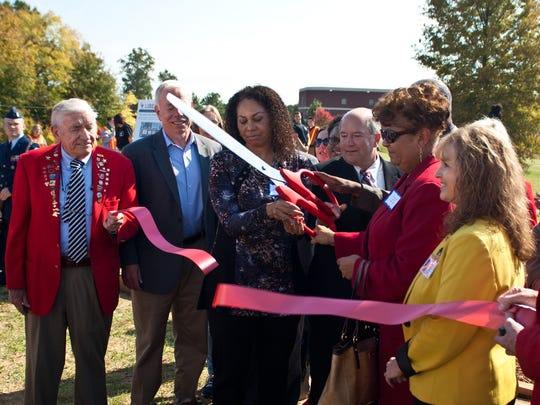 June Murray, principal of Liberty Technology Magnet High School, and Verna Ruffin, superintendent of Jackson-Madison County Schools, cut the ribbon Friday to open Liberty Acres, a 4.4-acre property for the agriculture program.