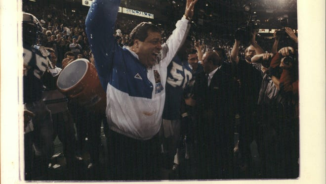 Lions coach Wayne Fontes exults sunday seconds after Lions players drenched him with a bucket of water.