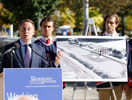 Westchester County Executive Rob Astorino flanked by