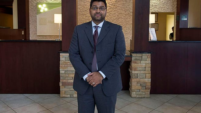 Himanshu Karvir, general manager of the Holiday Inn West, stands inside the lobby Monday November 9, 2015.