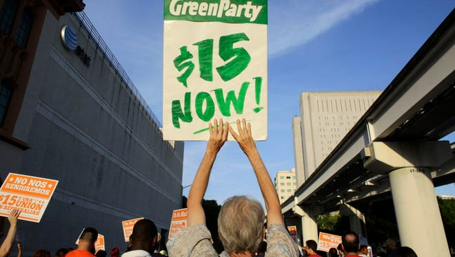 Protestors march in support of raising the minimum wage to $15 an hour as part of an expanding national movement known as Fight for 15, on Wednesday, April 15, 2015, in Miami.