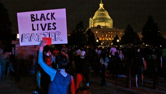 A Black Lives Matter sign is held up near the Capitol  during a protest on Thursday, July 7, 2016, in Washington.