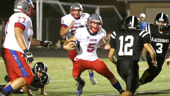 Madison quarterback Colby Edwards runs the ball through the North Buncombe defense during Friday night's game at North Buncombe. Madison won, 26-16.