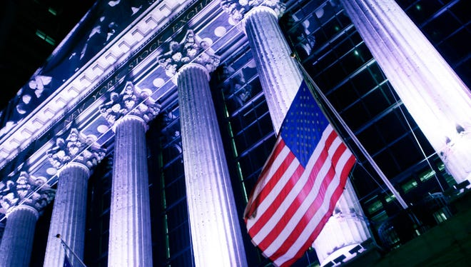 The Dow Jones industrial average and the Standard & Poor's 500 Index climbed to records on Wednesday.