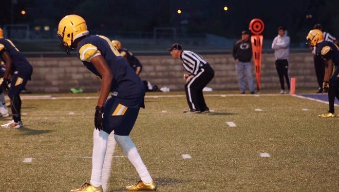 Jaylon Reed lines up across from a reciever, ready to make a play in his Junior season at Olive Branch.