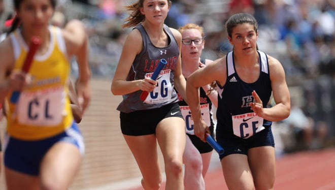 Samantha Biss of Lakeland (center) was second in the 1,600 meters at Group 2 sectional meet.