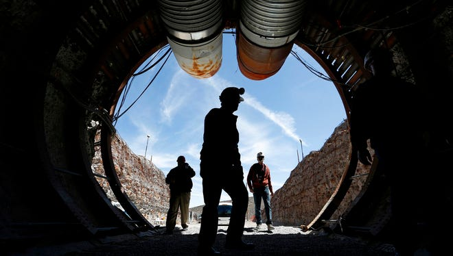In this April 9, 2015, file photo, people walk into the south portal of Yucca Mountain during a congressional tour of the proposed radioactive waste dump near Mercury, Nev., 90 miles northwest of Las Vegas.