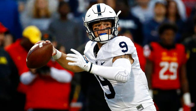 Penn State quarterback Trace McSorley throws to a receiver in the first half of an NCAA college football game against Maryland in College Park, Md., Saturday, Nov. 25, 2017.