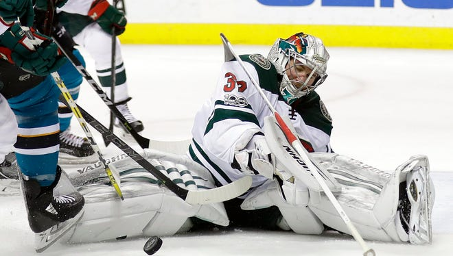Minnesota Wild goalie Alex Stalock stops a shot against the San Jose Sharks during the second period of an NHL hockey game Sunday, Dec. 10, in San Jose, Calif.