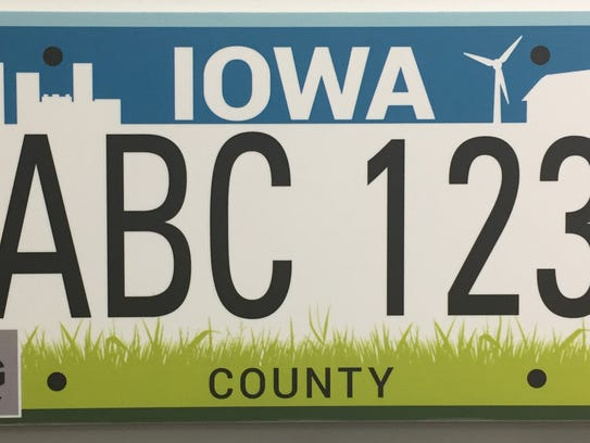 CITY AND COUNTRY REBOOT: This is aimed at providing an updated and more visually compelling representation of the urban and rural theme now used on Iowa's license plates. The top blue border profiles city and country images and the bottom green border is intended to evoke growth, nature and wellness.