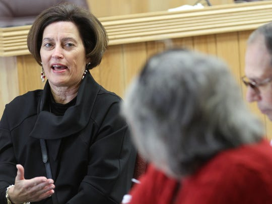 City Councilor Gayla McCulloch speaks during a meeting with U.S. Housing and Urban Development enforcement analyst Jerry Creamer Wednesday at City Hall in Farmington.