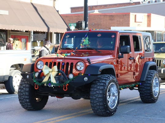 Kevin Hooper and family driving their winning Christmas jeep in the parade.