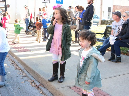Hadley and Harper Mercer enjoy the Christmas parade.