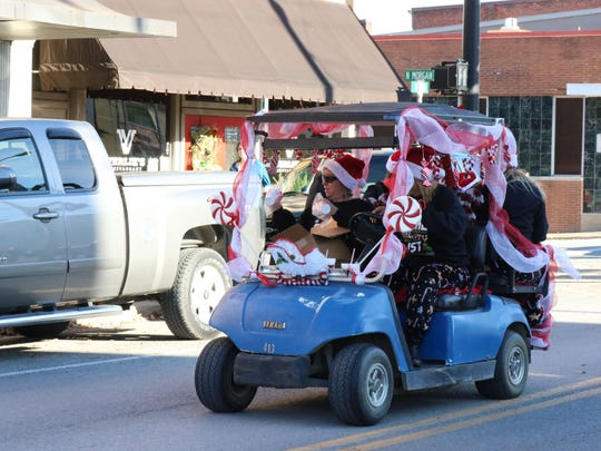 Cash Express joining in on the holiday fun during the Christmas parade in downtown Morganfield.
