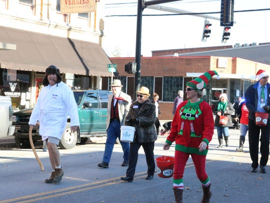 United Community Bank employees dressed up in Christmas attire during the parade.