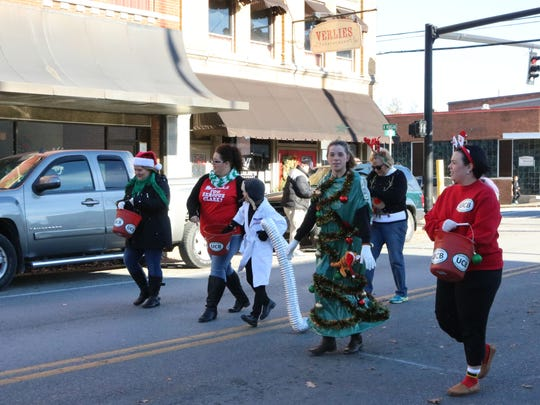More United Community Bank employees marching in the Christmas parade.