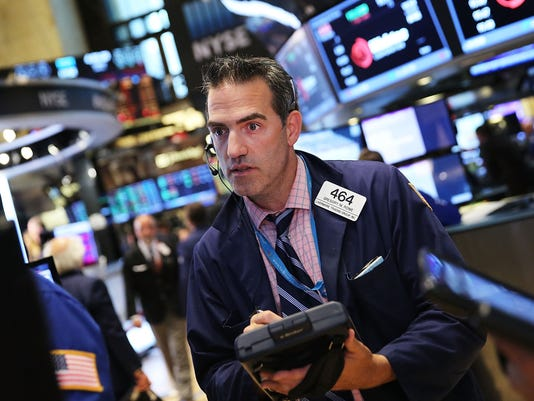 Dow sheds 128, oil slips under $48 after China plunge
