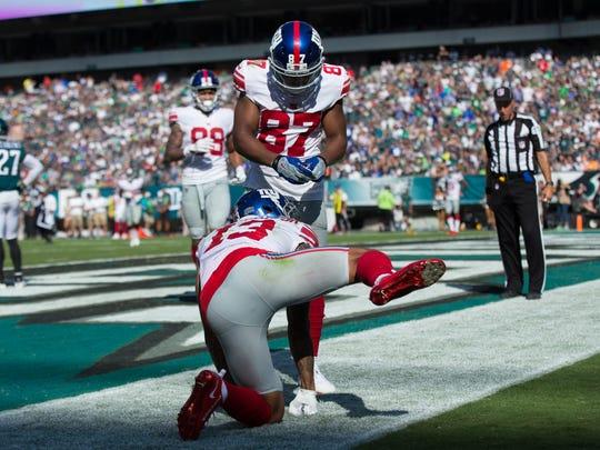 Odell Beckham Jr. gestures after scoring a touchdown.