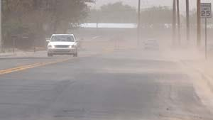 Wind gusts blow dust and sand over Farney Lane in April 2011.