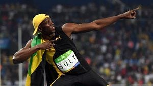 Jamaican sprinter Usain Bolt celebrates his third Olympic Gold medal in the 100 meters