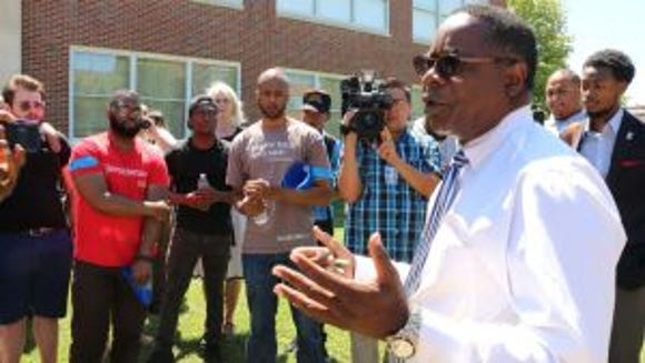 Middle Tennessee State University president, Dr. Sidney McPhee, announces the formation of committee to determine the fate of Forrest Hall during the March to Change the Name of Forrest Hall on Aug. 27 (Sarah Taylor)