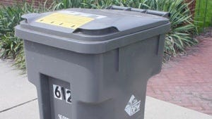 This is one of the 96-gallon trash carts provided by the Indianapolis Department of Public Works to residences on its trash collection routes.