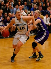 Victoria Galvan (30) of Manasquan drives to the basket