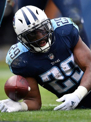 Titans running back DeMarco Murray scores in the third quarter Sunday.