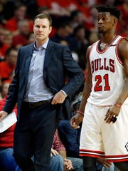 Chicago Bulls coach Fred Hoiberg, left, talks with Jimmy Butler during the first half in Game 6 of an NBA basketball first-round playoff series against the Boston Celtics, Friday, April. 28, 2017, in Chicago. The Celtics won 105-83. (AP Photo/Nam Y. Huh)
