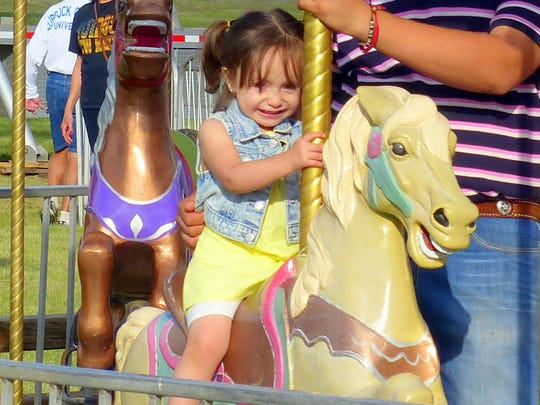 Nothing brings a smile to the face of the little girl faster than a merry-go-round.