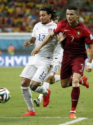 USA midfielder Jermaine Jones (13) and Portuguese forward Cristiano Ronaldo (7) battle for the ball during the second half of Sunday's record-setting World Cup game at Arena Amazonia.