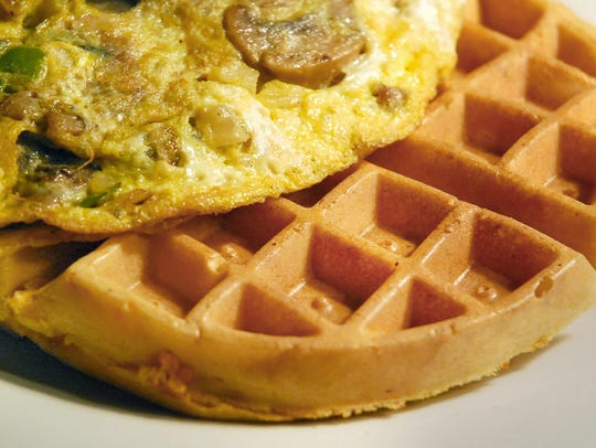 A hearty vegetable omelet and sweet potato waffle is