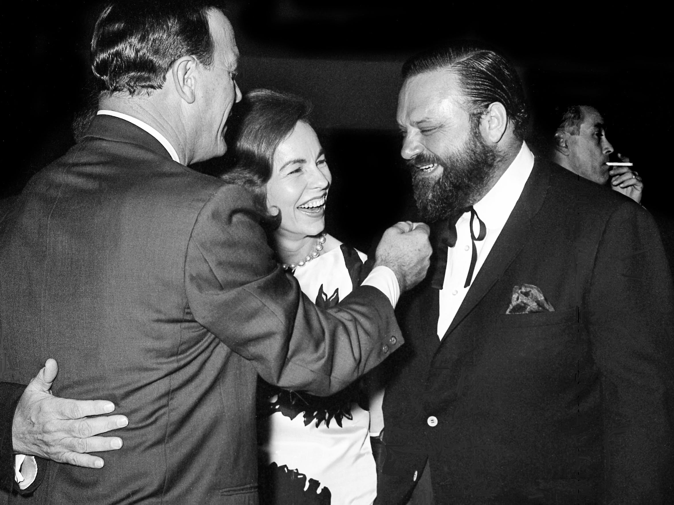 Eddy Arnold, left, Jo Walker of CMA, and trumpeter Al Hirt attended the grand opening of RCA Victor's new recording center March 29, 1965. Arnold is giving his fellow performer's beard a playful tug.
