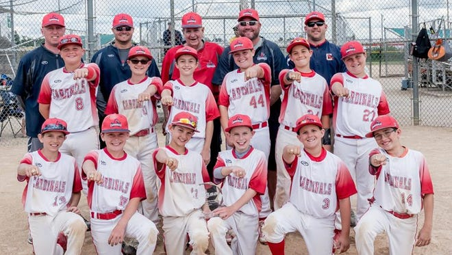 The 11-Under Canton Cardinals are all smiles after winning the USSSA state title.