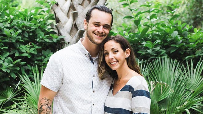 Angie Weber poses with her husband Ryne Weber. Angie Weber is in a coma after she was struck by a car while riding her bike in Lansing Township.