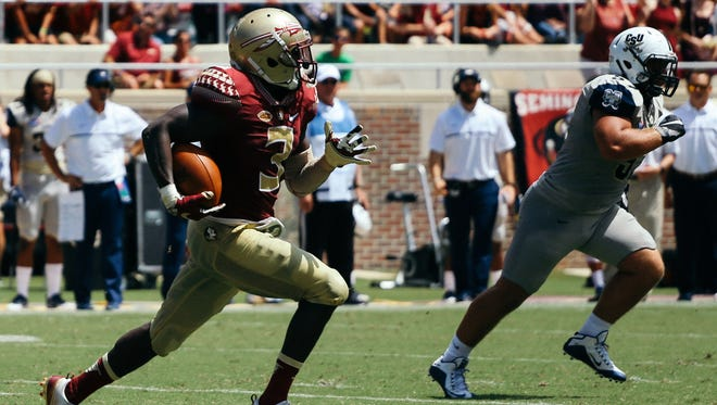 Bobo Wilson (3) returns a punt 89 yards for a touchdown against Charleston Southern. FSU won 52-8