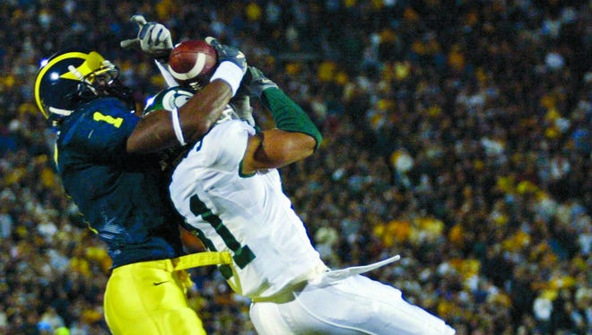 Michigan's Braylon Edwards, left, makes this touchdown catch over Michigan State's Jaren Hayes in the the 4th quarter on Saturday, Oct. 30, 2004, in Ann Arbor.