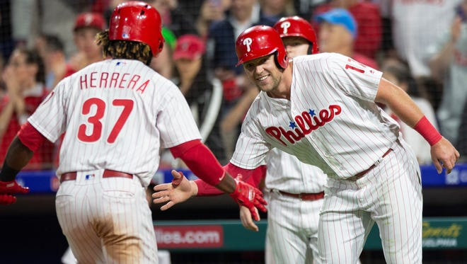 Philadelphia's Odubel Herrera (37) is cheered by Rhys Hoskins (17) after hitting a two-run home run earlier this season. The Phillies are off to a surprisingly good start in 2018. (AP Photo/Laurence Kesterson)