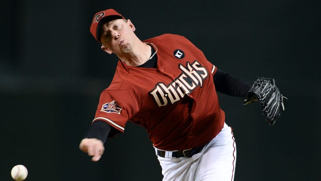 Aug 2, 2018; Phoenix, AZ, USA; Arizona Diamondbacks relief pitcher Brad Ziegler (29) pitches against the San Francisco Giants during the eighth inning at Chase Field. Mandatory Credit: Joe Camporeale-USA TODAY Sports