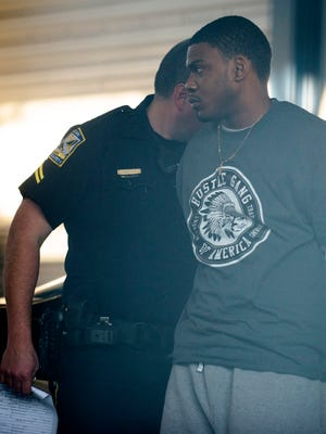 Markale Deandra Hart of Camp Hill, Ala., is taken into custody for the shooting death of Jakell Mitchell, an Auburn football player, on Sunday, Dec. 14, 2014, in Opelika, Ala. Hart has been charged with felony murder in connection with the fatal shooting of Jakell Mitchell. Charged with Auburn Police investigate a shooting at the Tiger Lodge apartments in Auburn, Ala., early Sunday morning.  According to the Lee County Coroners office t?he incident occurred at a residence in the 200 block of West Longleaf Drive in Auburn. Jakell Lenard Mitchell, 18, and current Auburn University football player was transported to East Alabama Medical Center by ambulance with apparent multiple gunshot wounds and died shortly after arrival at the emergency room from his injuries.