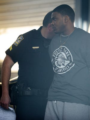 In this Dec. 13, 2014, file photo, Markale Deandra Hart of Camp Hill is taken into custody in the shooting death of Jakell Mitchell. Charged with murder, Hart is seeking immunity from prosecution under Alabama's stand-your-ground law.