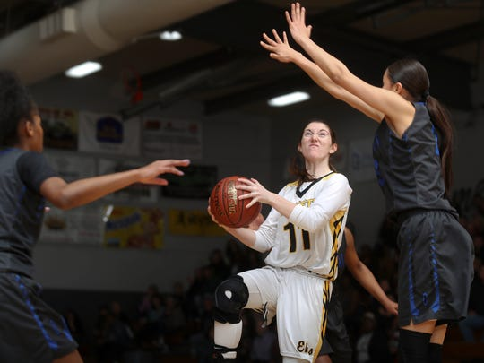 Karina Archibald of Enterprise gets through traffic Wednesday during her team's 67-63 win over Oakland.
